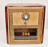 Gorgeous inlaid wood PO Box coin bank with antique brass door. Original Post Office box with combo lock. The wood part looks to be handmade and the inlay detail is gorgeous with varying wood grain shades of brown in a chevron design. There is a slit in