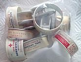 Bag of 6 Vintage Adhesive Medical Tape Containers.