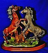 This lively Equestrian statue comes to us handmade from Italy. The Crown marked Dear Sculpture Artistiche is hand painted.