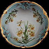 "The bowl is 9"" across and approximately 3"" deep. It has gold embossed scalloped edges."