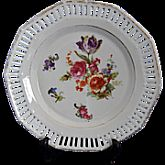 "The dish is approximately 7"" across with a colorful assortment of roses, lilies, and perennials.   The back of the dish has the Schumann Crest with ACS and Bavaria inside and topped with Royal Family's crown."