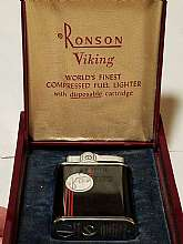 "Vintage Ronson Viking lighter in original deep red art deco case. Lighter is made of baked-on black over stainless with ""Ronson"" embossed on the top and identifying patents etc. embossed on the bottom.  there is a striking Art Deco red/silver de"