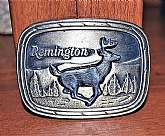 Very nice 1979 Remington Arms brass belt buckle. Running white tailed deer sculpted by Sid Bell.