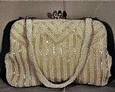 This is a lovely white and gold striped beaded evening bag clutch purse with a beaded handle.The handle can be used out side or left inside for use as a clutch.  Measures 7.25 inches wide by 5 inches tall (not including clasp).Would be suitable for a wed