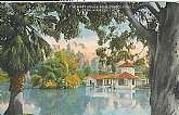 3 unused postcards of early California, 1930's to 1940's. 1st is a postcard showing the Boathouse at Hollenbeck Park in Los Angeles around 1930. Second is showing a monument on the International line, Mexican border, near San Diego. Third is the glass bot