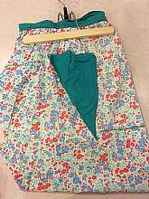 Lovely vintage hand made apron from the 40's or 50's. You can wear it the next time you whip up a batch of chocolate chip cookies or you can use it as neat vintage kitchen decor. This apron is unique as it has a triangle pocket!****Ashley's Eclectic Att