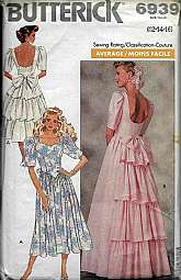 Butterrick 6939  Size 12-14-16 Vintage Sewing Pattern 1988 Wedding Dress Bridesmaid Three quarter sleeves, bow bustle ruffle layer backScoop open back.Factory Folded Uncut. Envelope has shelf wear, instructions include.