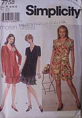 Petite Dress Simplicity 7758, Dated 1997 Pullover Dress, Flared Skirt, Short Long Sleeves, V-neck Bodice Side Slits, Back Tie Ends, Mock buttons down front.Uncut Factory Folded, envelope has some staining, tissue pattern unaffected and free of any sta