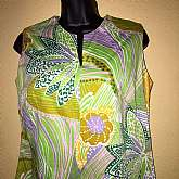 "Vintage 60's Original Hawaiian RomperV-Cut Neckline-SleevelessMulti Color Tropical Floral Print With Green BackgroundWide leg cut (super cute)Back zipper closureMade by Ja-Na Of HawaiiGreat vintage condition Measures lying flatchest 18"" acros"