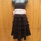 Betsey Johnson Evening/Cocktail Strapless DressBoned bustier bodiceTiered Black CrochetPink satin ribbon below bust that runs to back into a large cute sexy bowBuilt in petti coatBack zipper closure Labeled size 4Measures lying flatchest 15""