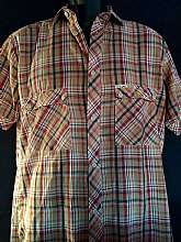 "Vintage Wrangler Western plaid short sleeve shirtCollard with center button closureTo flap pockets with button closureWrangler label tag on pocketSize mediumMeasures lying flatChest 21"" across 42"" total Sleeves 9""Total length should"