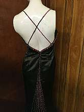 Solid black Pageant gownSolid black with fuschia colored beading and sequinSpaghetti strap criss cross back with beaded/sequin trim that runs down center of trainChest is a sweetheart cut shape v-shape that has a thick band trim of sequin and beads tha