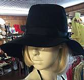 "Hippie wide brim slouchy hatSolid black with black ribbonHead is linedMade by Sears MillineryMeasures inside crown 20"" wide and 4"" deeprim measures 44"" totalGreat vintage conditionFREE U.S. SHIPPING"