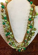 "Stunning piece perfect for spring & summer5 layered chain and beaded necklacechains are different styles of linksbeads are different green tones with gold and crystal combinationRare one of a kind pieceGreat vintage conditionMeasures24"" to"