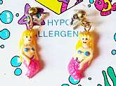 Here is a really cute pair of New Vintage Merry Mermaid Earrings Hypo Allergenic by Harry Ash Expressive Kids Novelty Jewelry from 1992. These are from my Grandmother's estate jewelry collection and are new never worn and still on card. They are for pierc