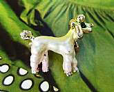 Vintage 1950's White Enamel Rhinestone Poodle Dog Miniature Scatter PinA cute vintage white enamel poodle dog scatter pin with a sparkling green rhinestone eye.  Gold tone head and pom pom tail complete the look.  Very good vintage condition with minor