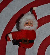 Vintage clip on of Santa used for decorating or can be worn.