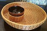 Vintage Wicker Rattan Serving Tray!Perfect for adding a layer of natural rustic goodness, this rattan serving piece is shaped like a palm frond and has a removable stainless bowl for sauces or dips. In wonderful condition, piece has a lovely woven desig