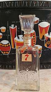 This liquor decanters was purchased at a SHAKER HEIGHTS ESTATE SALE. They are Mad Men in style. However, they were made my different manufacturers in the late 1960s-early 1970s. Seagrams 7 CrownIt is in wonderful condition. The glass is pristine without