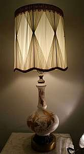 Lamps are made of white frosted glass. Decorated with flowers with gold leaves. The shade is an original vintage shade that was still wrapped up and new when the base was purchased. It is in perfect shape and a beautiful accent for this lamp.This lamp