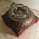 This is an exquisitely antique solid cast iron Art Deco ashtray with thick glass insert in perfect condition.made early 1900's It has a very ornate cast iron base which is very thick and also painted by hand.the shaft is made from solid iron