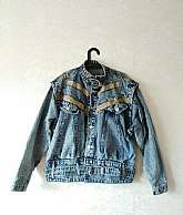 Gabis 1980's vintage oversized  blue acid wash denim jacket with two brown panels.  The jacket has silvertone button fastening with buckle to neck with an adjustable belt.  Buttons on each cuff in size medium/largeMaterial: 100% CottonIn very good vin