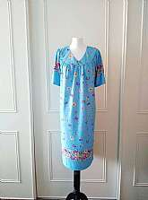 I have for sale this floral and butterfly print blue, yellow, pink, green and black mid length short sleeved summer dress with pocket to the side by Metropolitan in size large (12/14/16)Made in IndiaMaterial: 100% PolyesterIn very good vintage condi