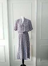 SALE REDUCED FROM £25I have for sale this floral print Eastex Heirloom Collection 1980's vintage mid length dress in purple blue and white with shoulder pads anelasticated waist and button fastening with attachex belt in the same material in