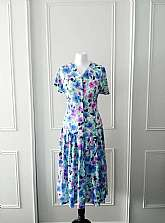 I have for sale this floral print (pink, blue, white, green and black) 1980's vintage mid length drop waisted summer dress with button fastening to the top and pleated skirt in size 12Measurements laid flatShoulder to shoulder: 17