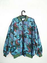 I have for sale this Dragon unisex oversized 1980's vintage patterned fully lined silk bomber jacket with zip fastening in size small (would fit sizes 12/14/16)In very good vintage conditionMaterial: 100% SilkWorldwide postageFor more information