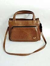SALE REDUCED FROM 45I have for sale this Paludas 1970's vintage brown soft leather  shoulder bag with detachable shoulder strap and top carry handles.  The bag has an outside fully lined zipped compartment.  The inside of the bag is fully lined with mul
