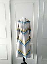 I have for sale this 1970's vintage mid length long sleeved striped dress with large collar and zip fastening to the back with an attached belt.  There is no size, but would fit a size 12Measurements laid flatShoulder to shoulder: 15