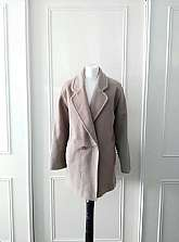 I have for sale this beige warm fully lined winter coat by English Lady the the coat has 2 large double buttons to fasten with front pockets in size 14The coat is oversized so could fit a 12,14,16, but check measurements belowMeasurements laid flatSh