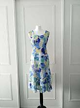 Reduced to clearI have for sale this Afibel 1990's vintage floral print blue, green, yellow and white mid length sleevless dress with floaty material.  The dress is fully lined with zip fastening in size 12.  The dress would make a lovely wedding dress