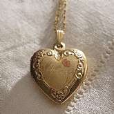 Beautiful vintage gold filled engraved heart Mom locket necklace.