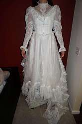 Amazing vintage Victorian or Edwardian style wedding dress with high neck and tiered ruffles.  The dress is made of floaty chiffon fabric with lace accents and puffed sleeves.  This dress is so elegant and beautiful on.  It is about a size 4/6 and measure