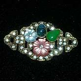 Beautiful vintage 1960s rhinestone lucite fruit salad flower cabochon brooch pin.  The flowers and green cabochon are lucite, the blue cab is glass and there are pave' set rhinestone accents in the background.  It is heavy for its size and very well made.