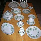 Absolutely stunning 12 place set of Johann Haviland JOH184 Green Rose Garland dishes in a green and pink rose motif with silver or platinum trim.  The set is beautiful and has lovely curved or scalloped edges.   There are 90 pieces in the set  which consi