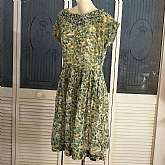 Gorgeous vintage 50s rockabilly secretary day dress in lovely green cotton voile fabric with metal side zipper. The dress has pleated neckline and full pleated skirt. Dress is handmade and could use some restitching as some of the old stitching is beginni