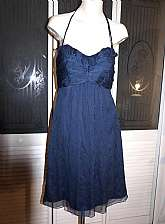 Lovely Amsale tissue silk chiffon convertible halter strapless dress in lovely midnight blue.  It is very figure flattering on and a beautiful design.  Tagged a size 8 and measures bust 34, waist 28, hips 40, length 41.