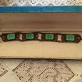 Wonderful vintage faux jade or jadeite filigree link bracelet with beautiful carved cabochon art glass.  It measures 7 1/2 inches long by almost 3/4 inches wide.  It is absolutely gorgeous in hand and much more beautiful than the photos portray.