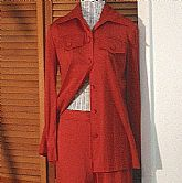 Wicked Retro Vintage 2pc Skinny Pantsuit by Lillie Rubin in a wonderful paprika colored knit poly fabric. Wonderful styling and very tailored close cut. The top is a button down with tab pockets and the straight front pants have a tab waistband and wide s