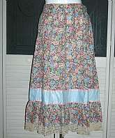 Absolutely perfect vintage boho indie hippie gypsy skirt in a beautiful multicolored floral print cotton.  It has a wide waistband and a solid pale blue band near the bottom right before the ruffled hem.  Tagged a size 14 by 70s standards and measures:  w
