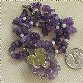 Killer retro 70s artisan necklace made from amethyst chip beads, mother of pearl beads and a grapes and grapevine pendant made up of wired amethust beads.  It is really amazing and a one of a kind piece that is gorgeous in hand.  Photos don't do it justic