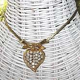 This gorgeous necklace looks like some of the early Coro Pegasus pieces. It has an elaborate and unique chain ending in a dramatic drop that is a rhinestone encrusted heart. It measures 15 1/2 inches and is in excellent condition. This is absolutely stunn