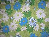 Sunny and bright vintage 50s daisy tablecloth that looks like a Vera but has no tag.  It is 78 inches round with great colors in blue, green and white.  Like new condition and 50s retrofabulous