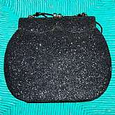 Art Deco or Art Nouveau vintage glitter shoulder bag purse in black. There is actually black glitter covering the entire bag which is really cute. It has a beaded strap with black glass bugle beads. Measures 7 1/2 by 6 inches not including strap. Perfect