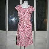 Gorgeous vintage 60s rockabilly shirtwaist day dress in a red white and pink crisp cotton.  It has a button down front, double patch pockets on the bodice, a Peter Pan collar and full darted skirt with side slash pockets plus belt.  It is in excellent vin