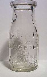 This Vintage Dairylea Dairy Men's League Co-Operative Association Inc Half Pint Milk Bottle  measures 5 1/2 inches high by 2 3/8 inch in diameter at the bottom. Crystal clear glass with a few light scratches and pits.  No cracks or chips.  The bottle is i
