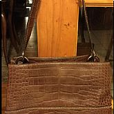 Small, over the shoulder handbag.
